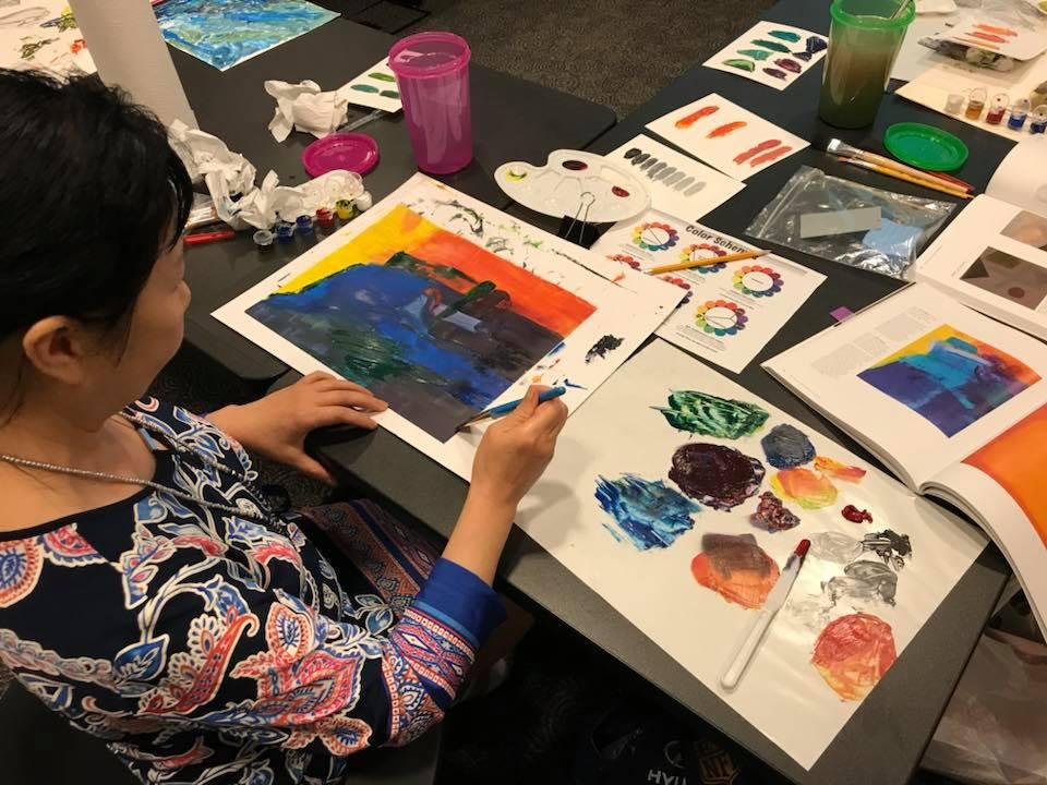 Woman painting during Arts and Crafts event