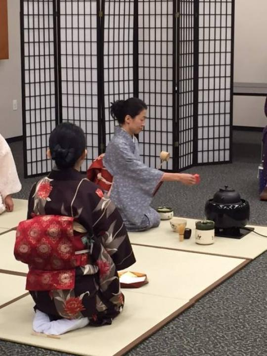Woman performing in tea ceremony at University Branch Library